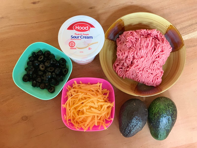Taco Tuesday just got a new dish - Taco Stuffed Avocados! Everyone loves family friendly, low carb, taco stuffed avocados and they're so easy!