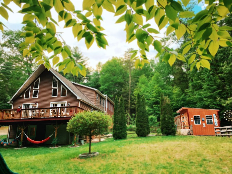 a-frame house with chicken coop