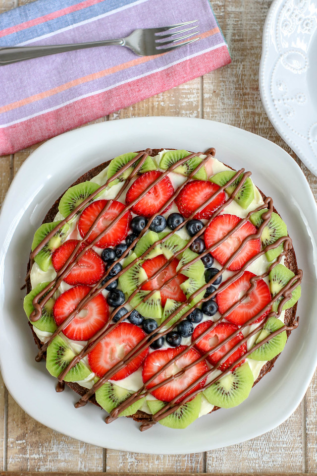This amazing Brownie Fruit Pizza recipe actually makes TWO 9 inch brownie pizzas, so you can have a real party or get together with an awesome summer treat!