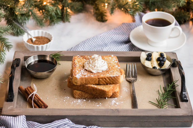 This Eggnog French Toast recipe is the most perfect recipe for Christmas morning, and for all of winter! Enjoy the festive spices and perfect toast crunch!