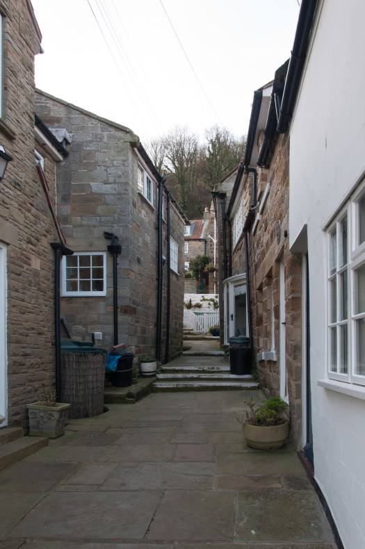 Cottages clustered around another alley
