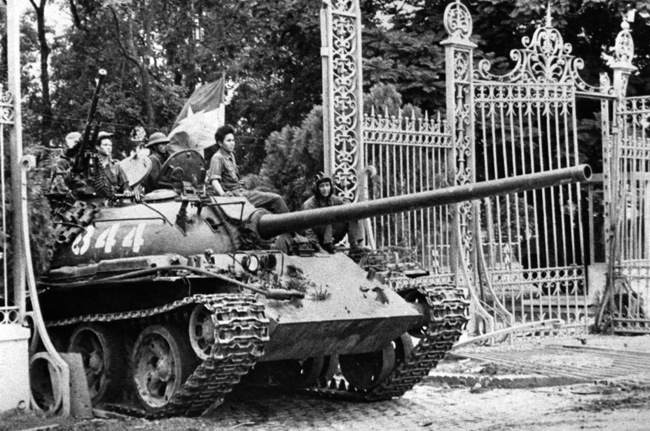 A north Vietnamese tank crashes through the gates of the Independence Palace in Saigon at the end of the Vietnam War