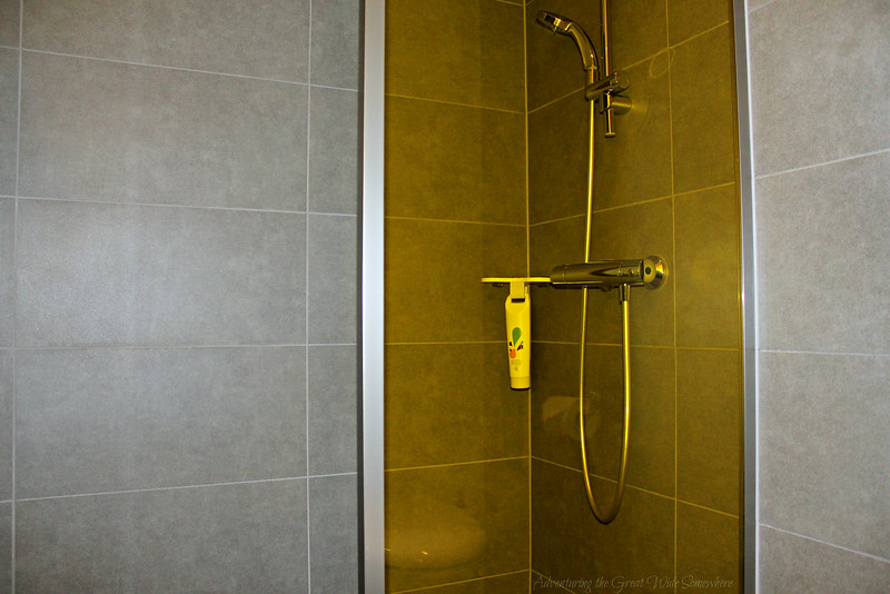 Modern lines and bold colors in the bathroom of the Hotel Ibis Styles CDG guest rooms in Paris, France.
