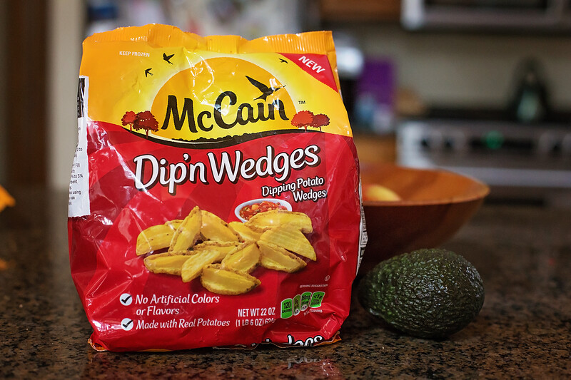#ad These delicious Loaded Potato Nachos use McCain Dip'n Wedges and are perfect to serve for time spent with family and friends! @McCainFoods #MadeToShare