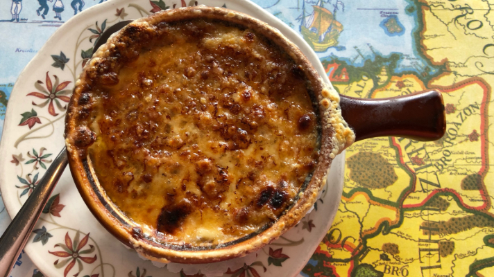 A bowl of traditional French Onion soup from Au Petit Coin Breton