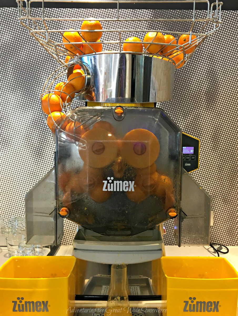 An orange juicer makes fresh orange juice for the free and delicious breakfast buffet at the Ibis Styles CDG in Paris, France.