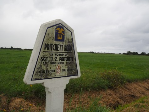 Memorial road sign for Sgt J. Z. Pritchett, killed in action 25 June 1944