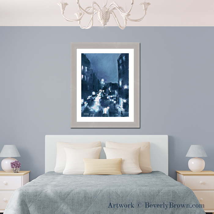 "Modern gray bedroom with New York wall art over the bed. The painting ""Across 23rd Street"" captures New York at night in shades of midnight blue, aqua and pink. From an original pastel painting by New York artist Beverly Brown. Framed prints and canvas art for sale at www.beverlybrown.com"
