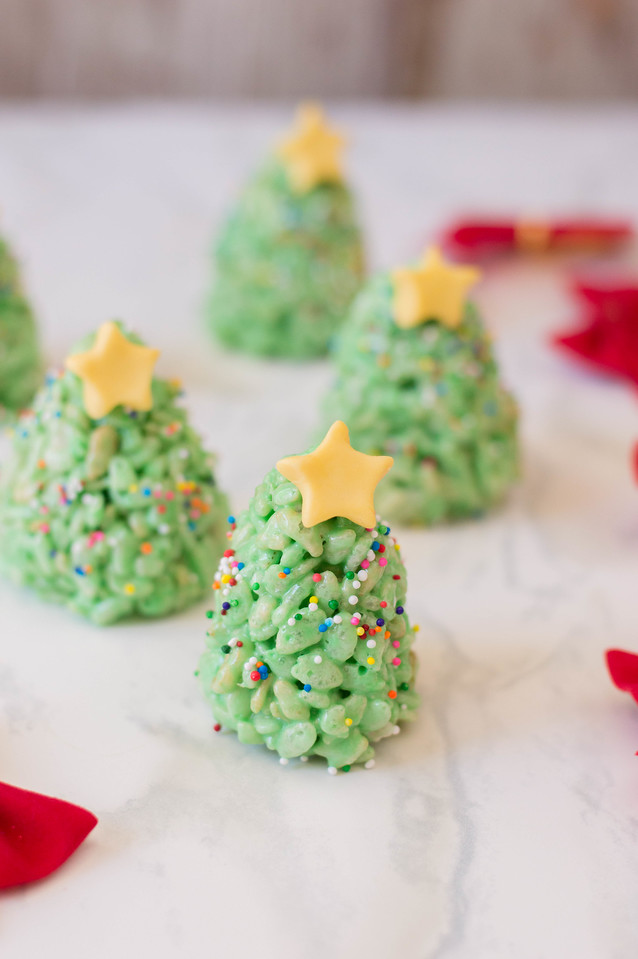 This Christmas Tree Rice Krispie Treats Recipe is designed to impress! They are cute, easy to make, and delicious too. An updated Christmas classic for you