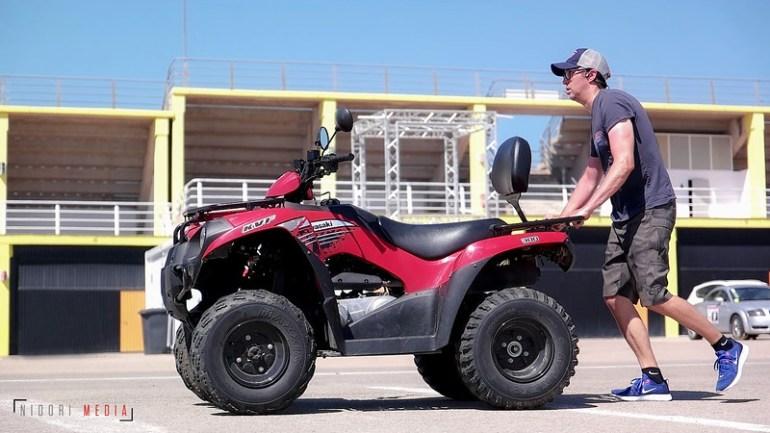 Kenny Noyes building leg strength by pushing a quad bike