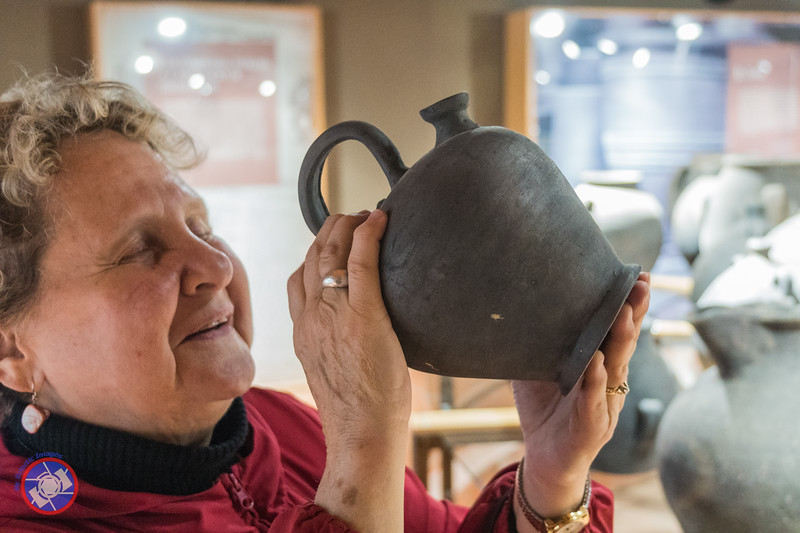 Examining a Typical Jug Made in Quart (©simon@myeclecticimages.com)