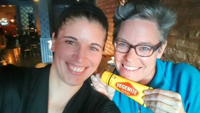 Selfie with two women, one holding a tube of Vegemite