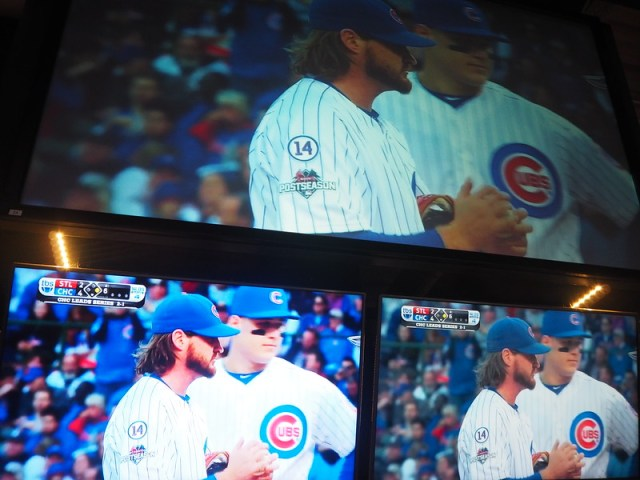 Three tv screens showing the same baseball game - Cubs v St Louis
