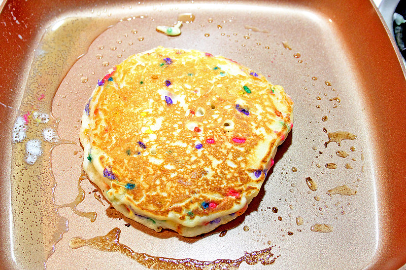 funfetti pancakes on griddle