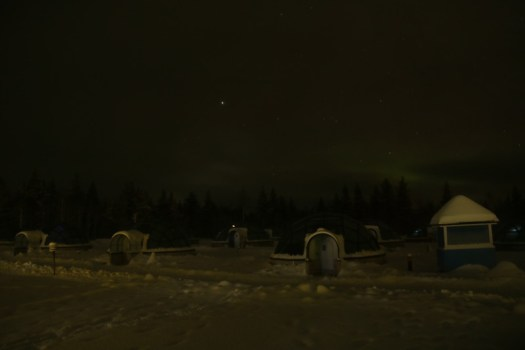 first signs of aurora in kakslauttanen lapland