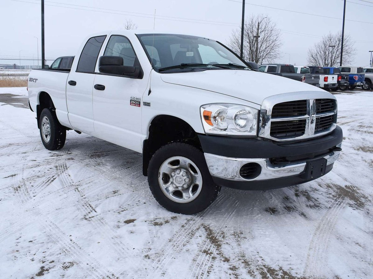 hight resolution of our 2009 dodge ram 2500 sxt quad cab 4x4 shown in bright white is a great truck for you power comes from a 5 7 litre hemi v8 that offers 355hp with ease