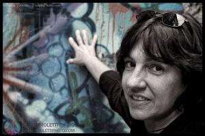 Touching the Berlin Wall by Steve Troletti