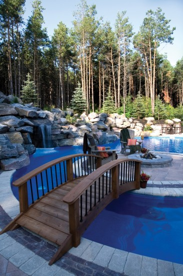 Umbriano pool deck with fire pit and waterfall  Photos