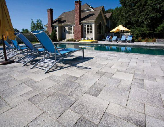 Umbriano pool deck with Unilock paver  Photos