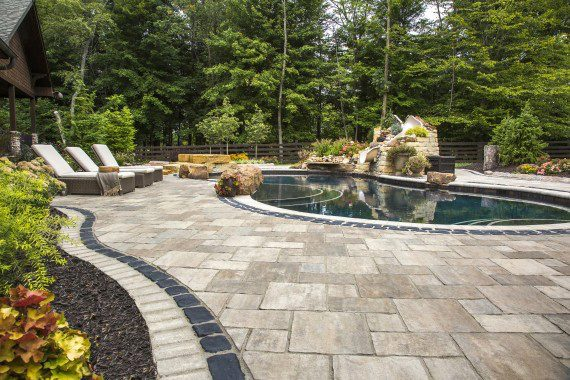 Beautiful Thornbury Pool Deck with Courtstone accent  Photos
