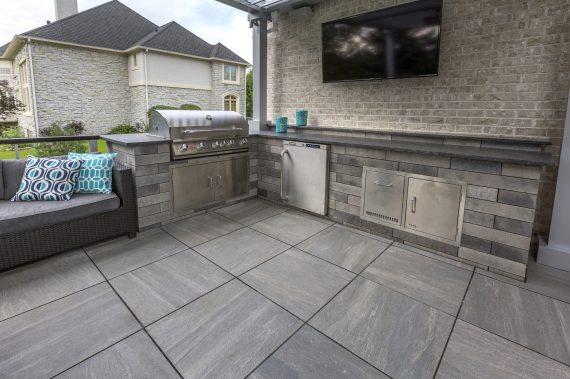 natural stone backsplash kitchen oakley sink backpack stealth black porcelain tile roof deck patio with an outdoor ...