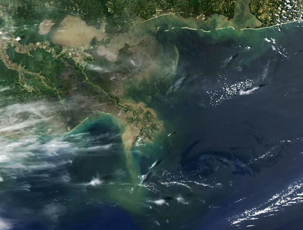 The oil slick from the Deepwater Horizon explosion and sinking is seen in the lower right area of this April 27, 2010 NASA photo in the Gulf of Mexico