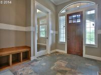 Craftsman Entryway with Chair rail & French doors | Zillow ...