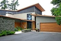 Modern Exterior of Home with Stacked stone wall & Metal