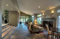 Contemporary Living Room with slate tile floors & Sunken ...