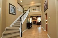 Traditional Staircase with High ceiling & Carpeted steps ...