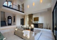Living Room with stone fireplace & travertine tile floors ...
