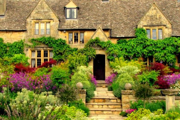 Traditional Exterior of Home with Raised beds, exterior stone floors, Skylight, Tudor Doors