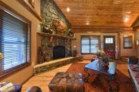 Rustic Living Room with Hardwood floors & stone fireplace ...