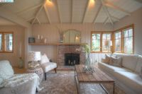 Cottage Living Room with Carpet & Cathedral ceiling in ...