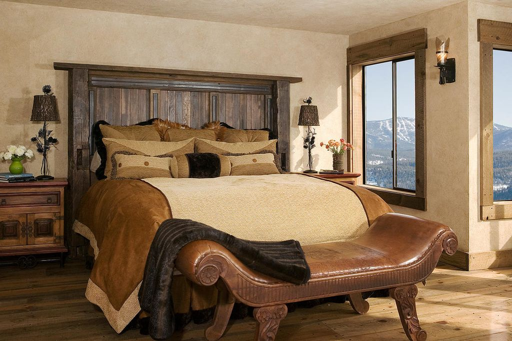 Rustic Master Bedroom With Hardwood Floors By High Camp