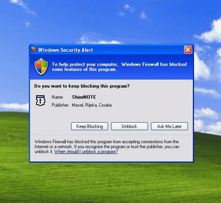 Windows XP Firewall security dialog where you must click Unblock button to enable sending and receiving notes.