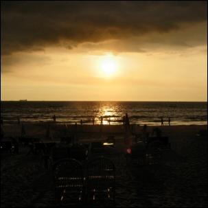 Sunset with dark clouds on Goa beach