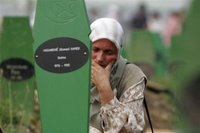A Bosnian Muslim woman mourns during a funeral ceremony for 505 bodies at the Memorial Center Potocari, near Srebrenica north of the Bosnian capital Sarajevo, Tuesday, July 11, 2006. The bodies will be buried marking the 11th anniversary commemorations of the massacre. Serb troops killed over 8,000 Muslim men and boys at Srebrenica in 1995, and most of the bodies are still missing. (AP Photo/Amel Emric)