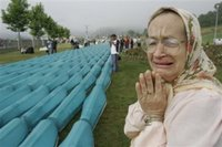 Bosnian Muslim women Hasiba Hadzic reacts as she finds name of her relative at the among 505 bodies to be buried during funeral ceremony at the Memorial Center Potocari, near Srebrenica north of Bosnian capital Sarajevo, Tuesday, July 11, 2006. The bodies will be buried marking the 11th anniversary commemorations of the massacre. Serb troops killed over 8,000 Muslim men and boys at Srebrenica in 1995.(AP Photo/Amel Emric)
