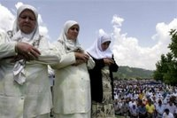 Bosnian Muslim women saying their prayers during the funeral ceremony for 505 bodies at the Memorial Center Potocari, near Srebrenica, north of Bosnian capital Sarajevo, Tuesday, July 11, 2006. The bodies will be buried marking the 11th anniversary commemorations of the massacre where Serb troops killed over 8,000 Bosniak men and boys at Srebrenica in 1995. (AP Photo/Amel Emric)