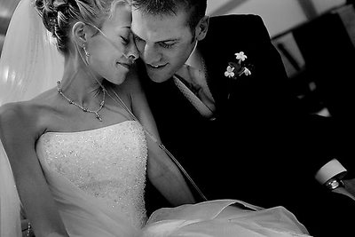 Katie Kirkpatrick, 21, and Nick Godwin, 23, cuddle up for a moment while waiting for the wedding photographer to get ready after getting married at Church of Christ in Hazel Park on Saturday January 15, 2005.