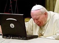 the great john paul II checking his emails ^_^