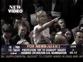 video: protester disrupts bolton hearing