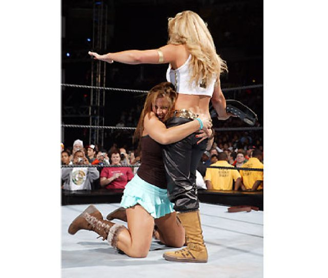 Trish Stratus Mickie James Is In The Ring And Introduces Us To The Greatest Womens Champion In Wwe History And Her Best Friend