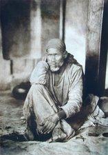 Shirdi Sai sitting near Dhuni