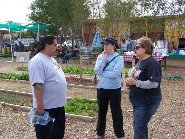 Sharon and Cindi talking to Natividad