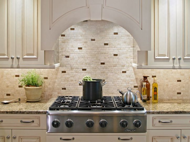 Kitchen Design Essentials Intricate Tile Design in Browns and Tans on Cream Tile Backsplash in Rustic Kitchen