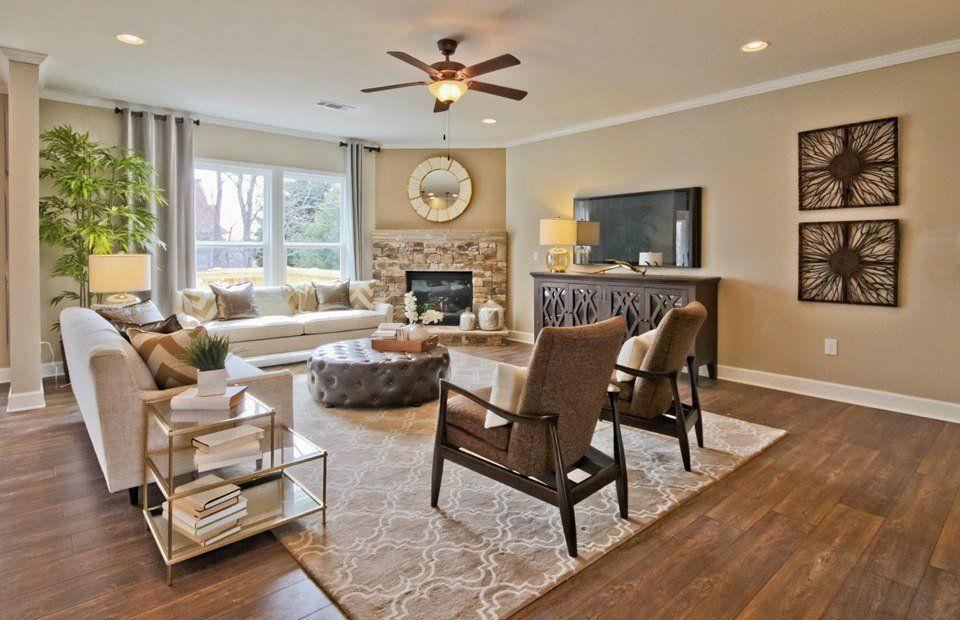 Transitional Living Room With Threshold   Starburst Mirror, Hardwood  Floors, Kaden Leather Round Tufted