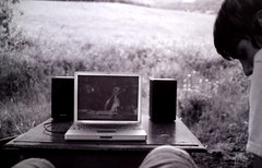 Powerbook, iPod, battery-operated speakers, picnic