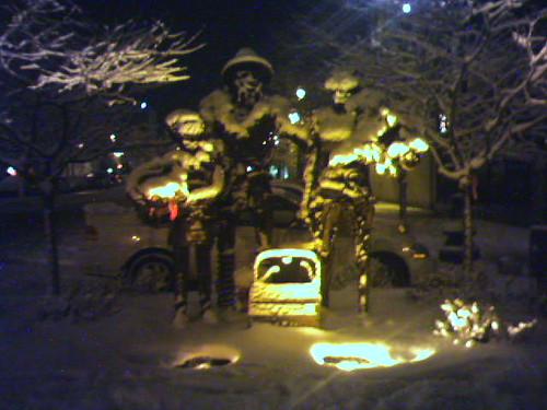 frozen metal people holding hands.